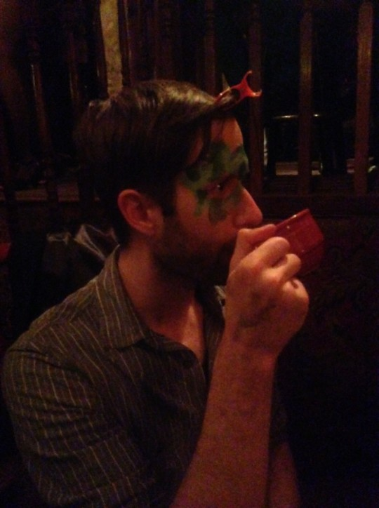 Carl having his face painted and sipping the concoctions from the open absinthe bar